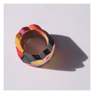 Ring constructed out of tessellating coloured pencils.