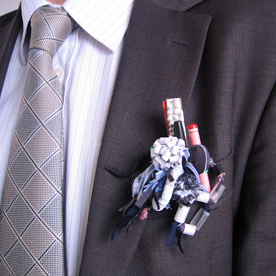 Close up of a man in a suit with an office folk assemblage in his pocket.