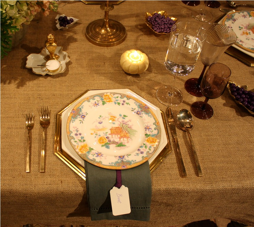 I love the simple burlap tablecloth mixed with vintage brass candelabras