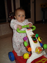 kynlee walking with her toy