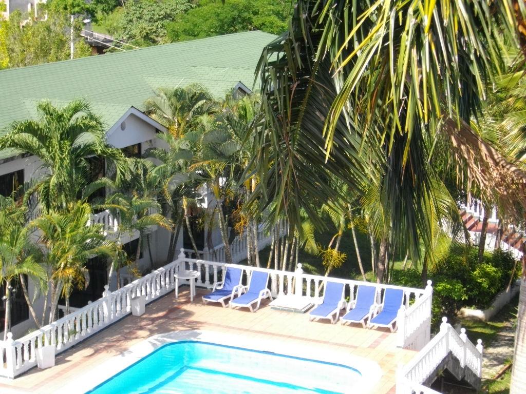 GIRARDOT HOTEL SAN MARCOS POBLADO: Areas de Piscina.