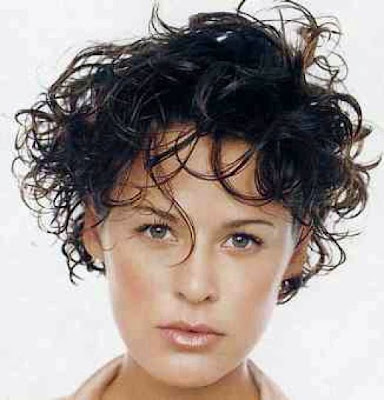 2005 short curls hairstyle. Curly hair was cut into short layers and small