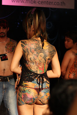 Sexy Girl with Japanese Geisha Tattoo on Tattoo Convention