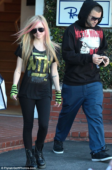 Untied: Avril Lavigne wears her laces undone on her Doc Martin boots as she