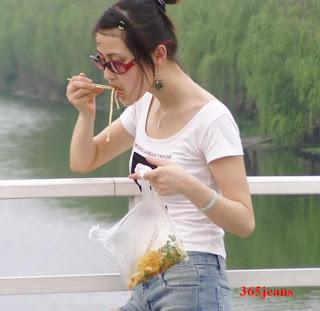 Eat noodles jeans shorts beauty girl