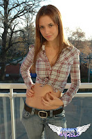 Light-haired Amy's the perfect country girl in a classic jeans