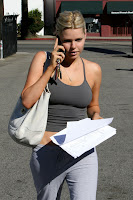 Sophie Monk Stretches A Tank Top