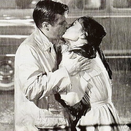 romantic couple kissing in rain. couple kissing in rain. a