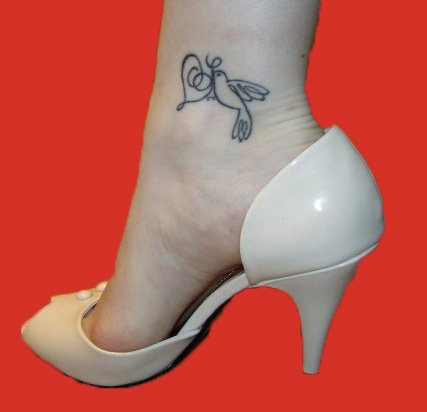 bow tattoo on ankle. sexy image of tattoo girls