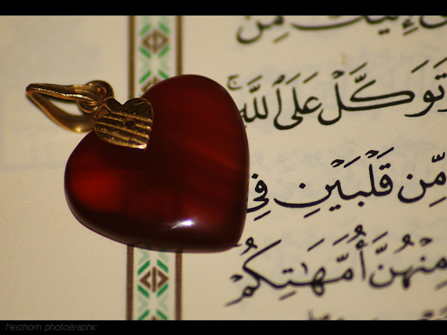 love pendant on AlQuran macro