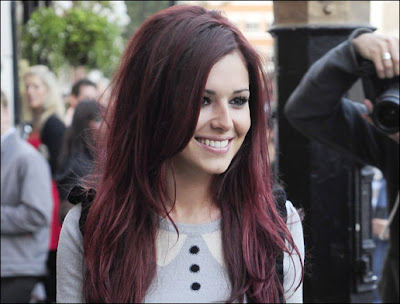 black hair with red underneath. Cheryl Cole and red hair would