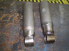 Front shock extenders