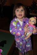 Katy with her new baby alive doll.