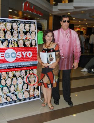 Diana Limjoco and hubby Dave Dewbre in front of poster of Gonegosyo book.