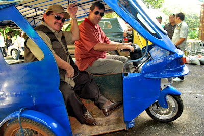 Dave Dewbre, CEO of Digital Web Group, Inc, taking Mayor Edward Hagedorn of Puerto Princesa City, Palawan for a spin on the new electric tricycle prototype.