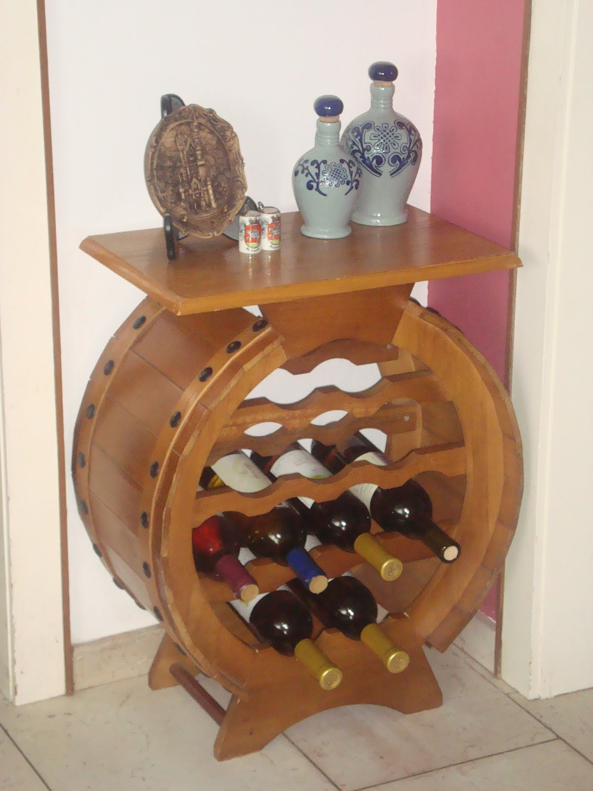 A Wine Rack I Got That Is Made From An Old Wine Barrel. I Picked It Up For  Only $50 Which I Think Is A Pretty Good Deal!