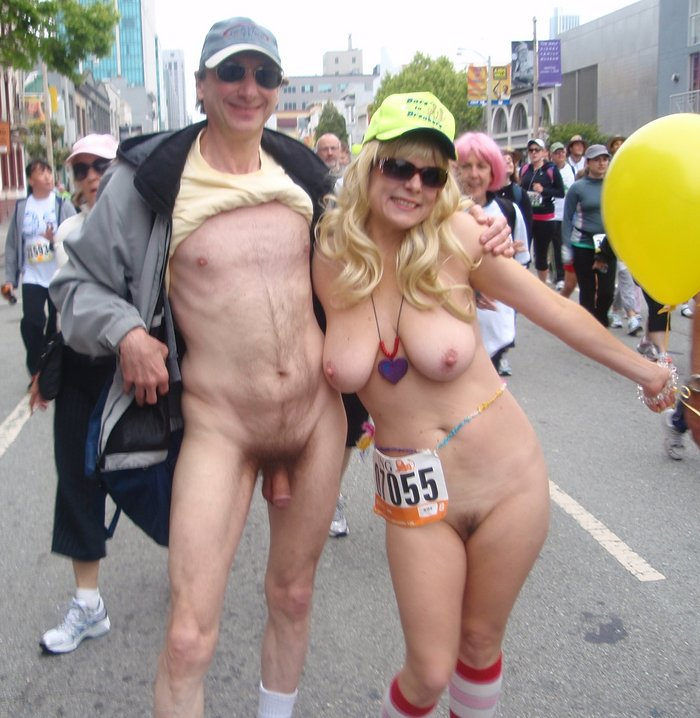Beautiful women posing with Brucie nude in public