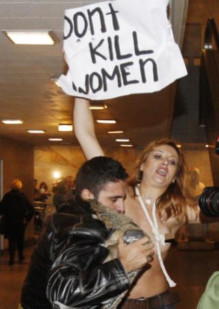 Activists from the women's rights group FEMEN protested semi-clothed outside ...