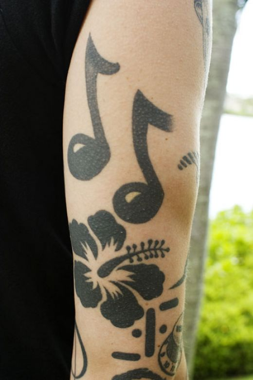 tattoos of music notes. music notes tattoos. of