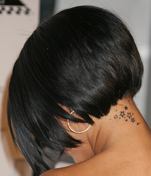 star tattoos on back. ack of neck tattoos.