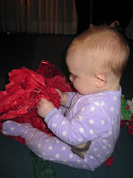 Evie opening presents
