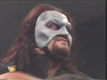The Undertaker wearing a Phantom like ghostly Grey upper faceMASK (1995)
