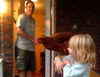 Eleanor holding chicken named Red