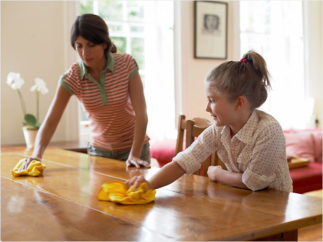 Mother daughter clean table