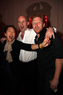 sandra oh and kevin mckidd at a party in london
