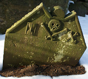 Tour Scotland Winter photograph of a Skull and Crossbones Gravestone in .