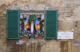 Colorful window in San Gimignano, Italy
