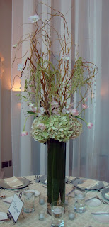 Ti leaf, Hydrangea, Tulip, Curly Willow,and hanging crystal and candle centerpiece