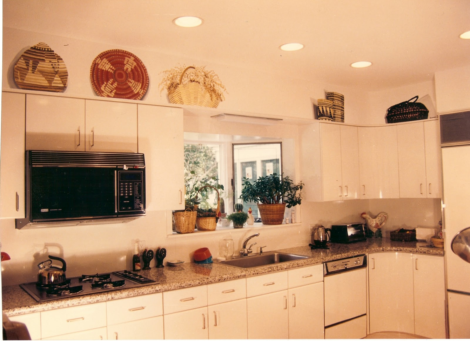 Baskets On Kitchen Top Cabinets
