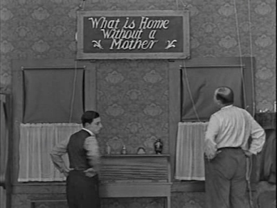 Buster Keaton. Scarecrow. What is a home without a mother sign