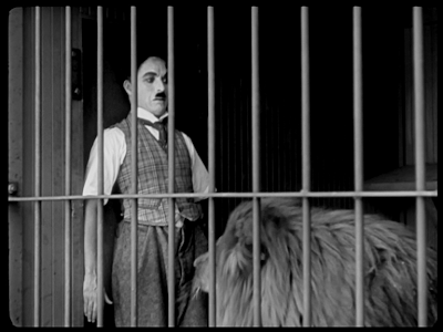 Charlie Chaplin. The Circus. lion cage