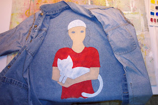 painted girl on denim jacket