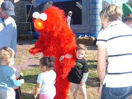 Zeke met Elmo at the Pumpkin Patch
