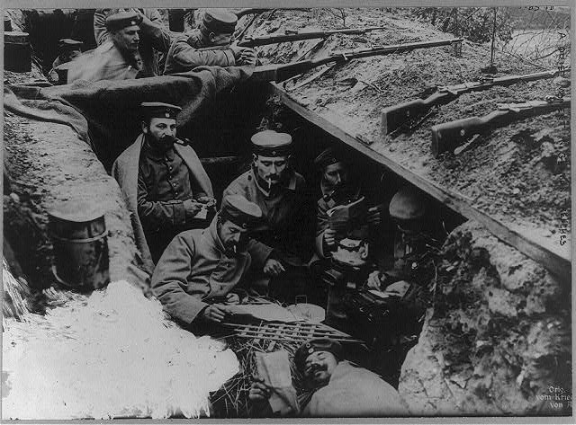 This photo shows a group of german soldiers in a ww1 trench library of