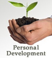 Hands holding a growing plant with the words personal development at the bottom