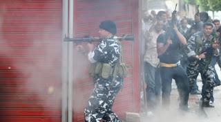Lebanese  Militia man takes aim in Beirut