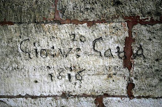 very old graffiti fonts on the stone wall
