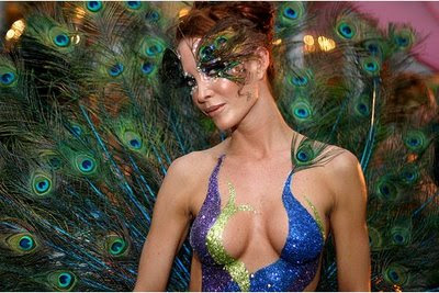 Beautiful Girl With Body Paint Art And Feathers Bird Background