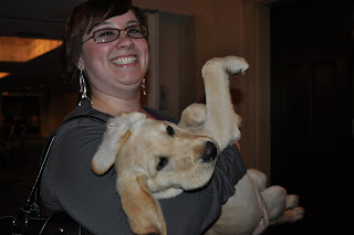 Picture of Erin holding Bob, She is laughing and he is on his back with his legs up in the air, his ears are all crooked too. He looks very out of it.