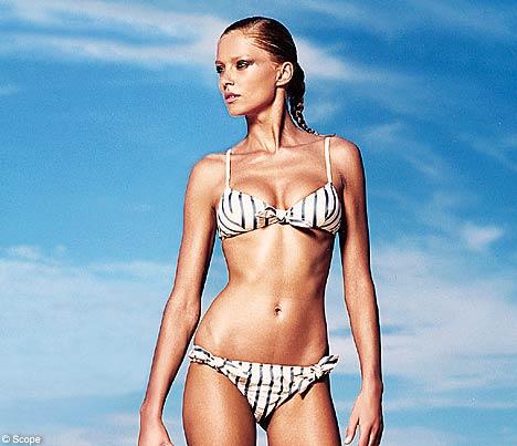 bikiniDM1905 468x403 Bar Refaeli slips into a sexy bikini while laying out in the sun on Monday ...
