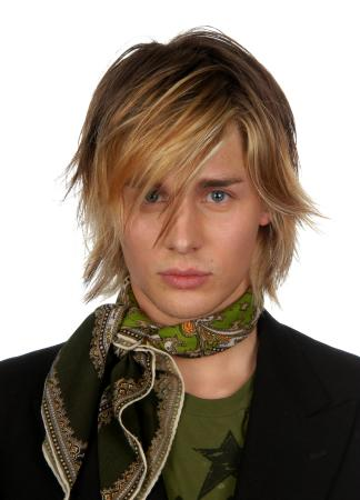 2005 men long hairstyle. Brunette hair was cut into mid length layers and