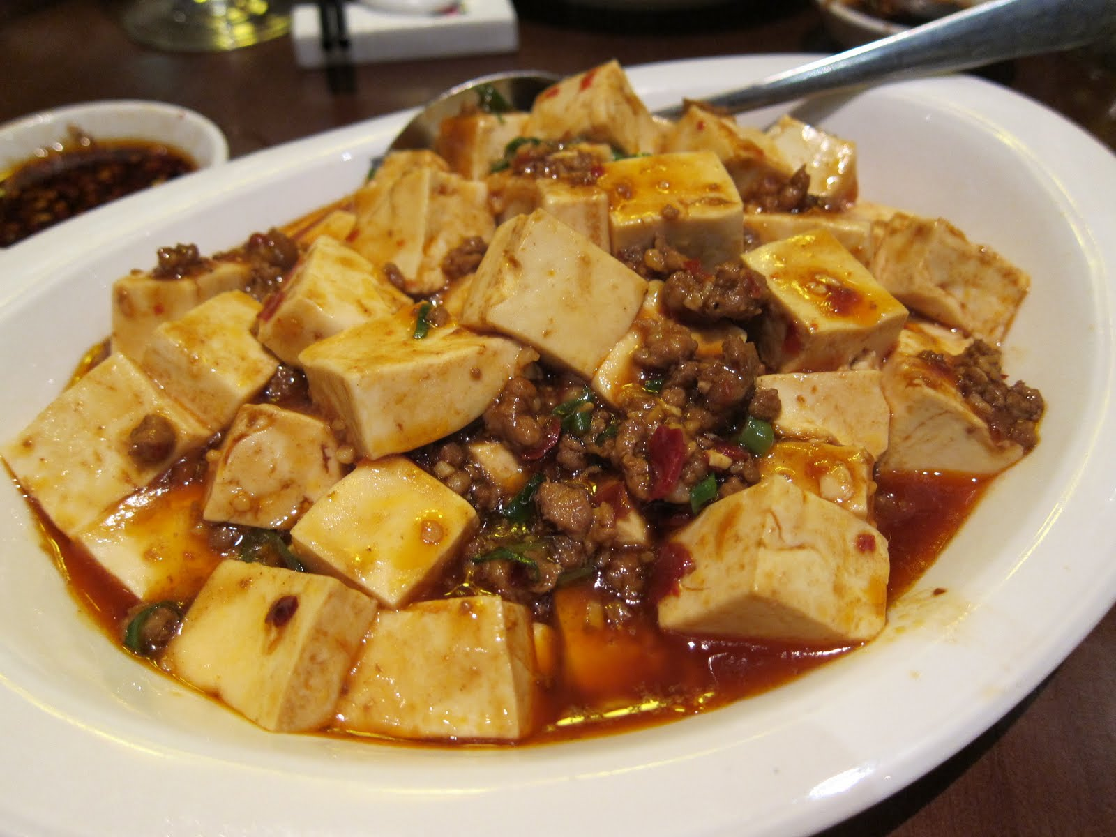 ... Tofu cooked in a spicy chilli and bean sauce with minced pork and