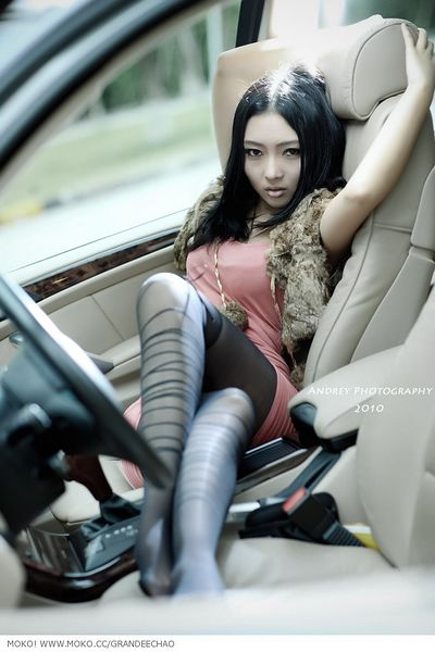Wonderful  Business Woman Wearing Short Skirt In A Car Using A Mobile Telephone