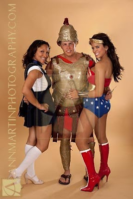 group full legnth picture of roman soldier in armor wonder woman costume and gossip girl costume