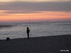 fishing at sunset at Foz do Arelho Beach