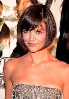Attractive brunette with a classic bob haircut with slanted bangs